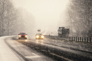 Snowstorm On Highway Vehicles Wallpaper