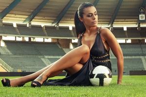 Soccer Girl With Football In Stadium Wallpaper