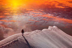 Standing At Snowy Peak Mountain Sunset Wallpaper