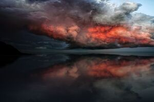 Storm Red Clouds Touching Ocean