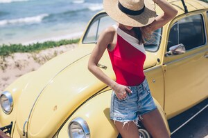 Summer Girl With Yellow Car Hat Wallpaper