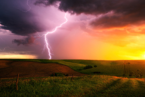 Thunderstorm Lightning Bolt Striking Down At Sunset In Nebraska 4k Wallpaper