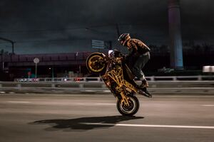 Urban Biker Doing Wheelie