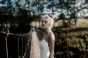 White Dress Girl On Bridge Pass 4k Wallpaper