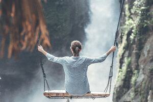 Woman Swings Near Waterfall 5k Wallpaper