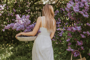 Women In White Dress Collecting Flowers 4k