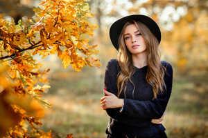 Women Outdoors Wearing Black Hat