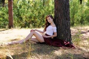 Women Sitting Under The Tree Outdoor