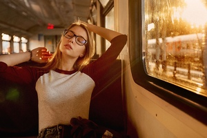 Women With Glasses Closed Eyes Sitting In Train