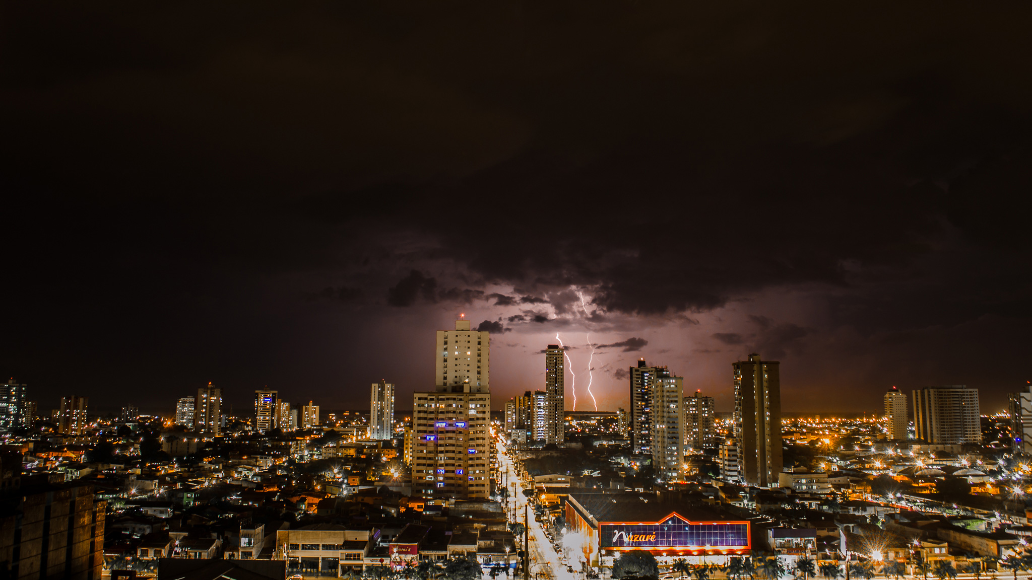 Thunderstorms Above City During Night