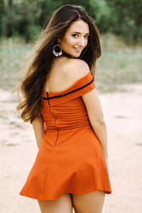 480x854 Andrea In Orange Dress Looking Back 4k