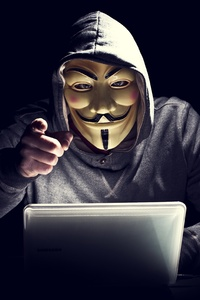 Anonymus Hacker In Mask Pointing Finger