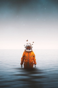 640x960 Astronaut Standing Inside Ocean Butterflies Around Helmet 4k