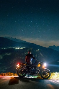 1280x2120 Biker Rider Chilling On Mountain Side 5k