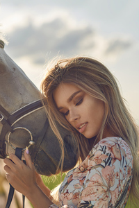 1280x2120 Blonde Girl Horse Hugging Eyes Closed 4k