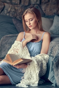Blonde Girl Reading A Book