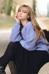 Blonde Girl Sitting Looking At Viewer 4k