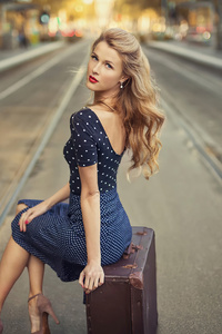 1080x1920 Blonde Girl Sitting Suitcase Train Station 4k