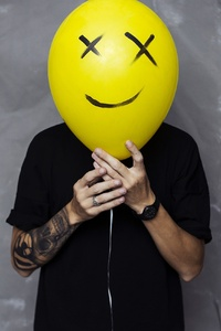 1280x2120 Boy With Smiley Balloon On Face