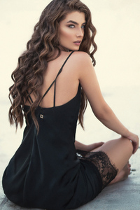 Brunette Girl In Black Dress Looking Back