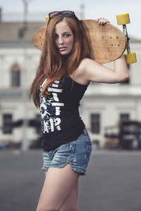 320x568 Brunette Girl With Skateboard