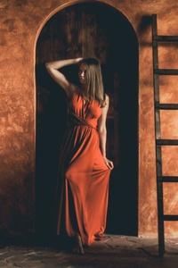 Brunette Standing Leaning To Door