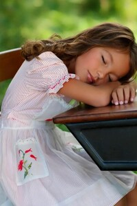 Child Sleeping On Table