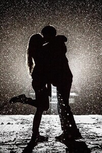 Couple Kissing In Snow Night