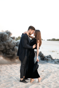 640x960 Cute Couple Black Clothing Beach Side