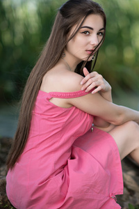 1242x2688 Cute Girl Sitting On Rock In Pink Dress Looking At Viewer 8k