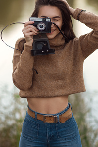 480x800 Cute Girl With Camera Smiling
