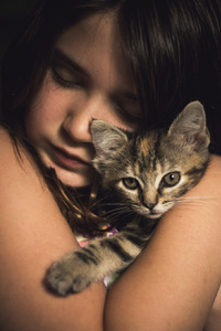 Cute Little Girl With Kitten