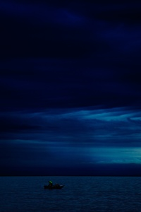 Dark Evening Blue Cloudy Alone Boat In Ocean 5k