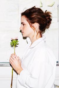 Emma Watson Holding Flower