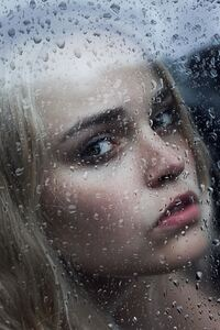 Girl Behind The Glass With Water Drops