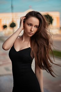 1280x2120 Girl Black Dress Hands In Hair 4k