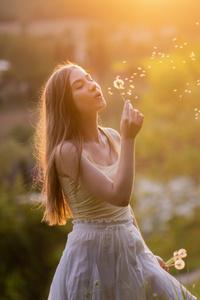 1440x2560 Girl Blowing Flower 5k