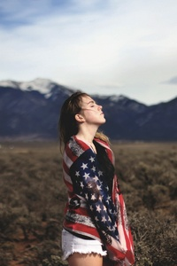 Girl Covering Herself With American Flag