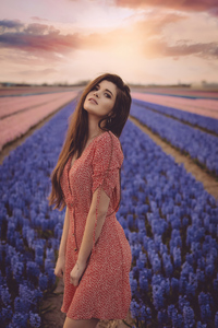 1125x2436 Girl Flower Field 4k