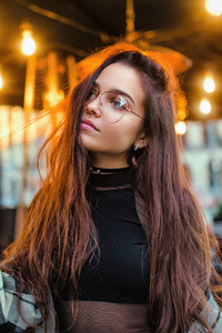 480x854 Girl Glasses Playing With Hair Restaurant Lights 4k