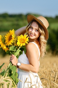 750x1334 Girl In Field With Flowers Sunny Day 8k