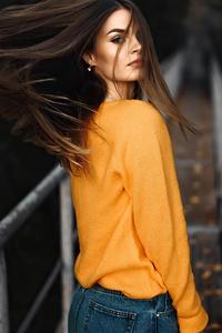 Girl Looking Back Orange Sweater
