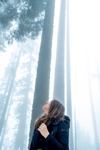 1080x2280 Girl Looking Towards The Tips Of Trees