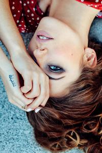 320x568 Girl Lying Down One Eye Covered 8k