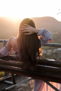 Girl Sitting Bench Back Hands In Hair Nature Outdoors