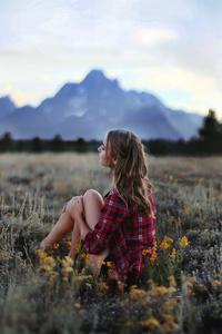 1080x2160 Girl Sitting In Grasslands 4k