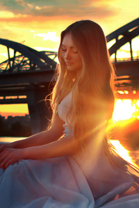 Girl Sitting On Bridge Side