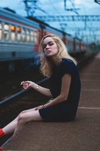 Girl Sitting On Platform Smoking 5k