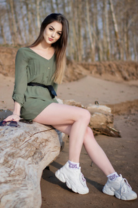 2160x3840 Girl Sitting On Wooden Trunk