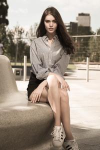 2160x3840 Girl Sitting Outside Portrait